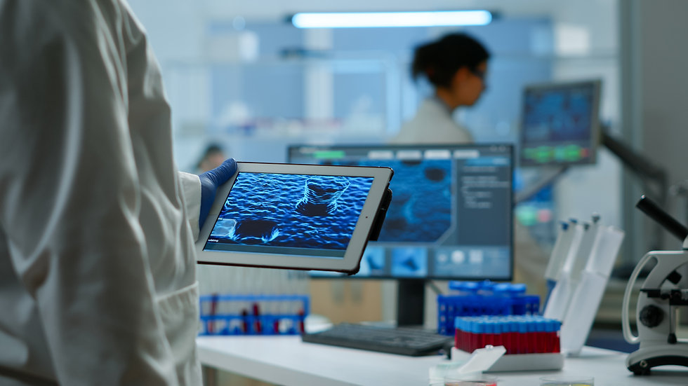 Close up of scientist in lab coat workin