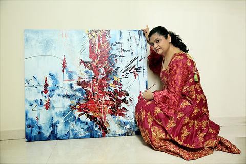 Artist Rritu Goel with her Artwork.JPG