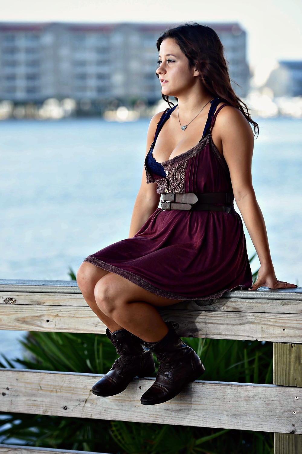 A style blogger wears a fall fashion outfit featuring a T-shirt dress and combat boots.
