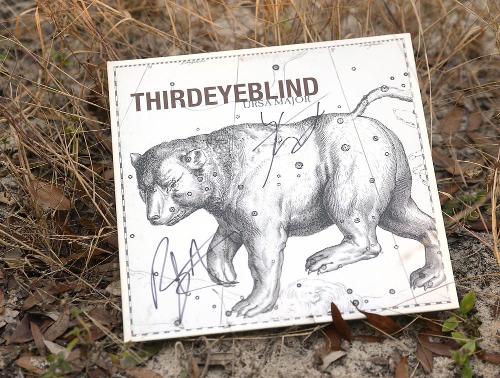 "Third Eye Blind's ""Ursa Major"" vinyl record sits in the grass."