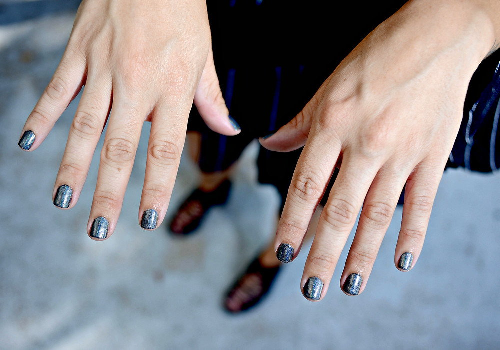 A beauty blogger shows off Urban Outfitters' hologram nail polish.