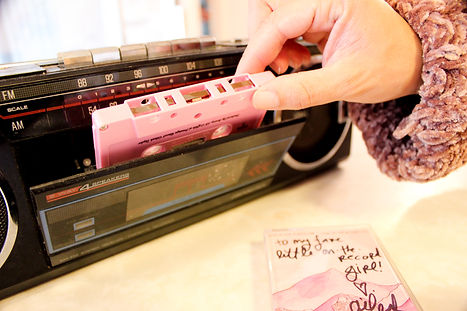 Pink cassette tape in old-school boombox