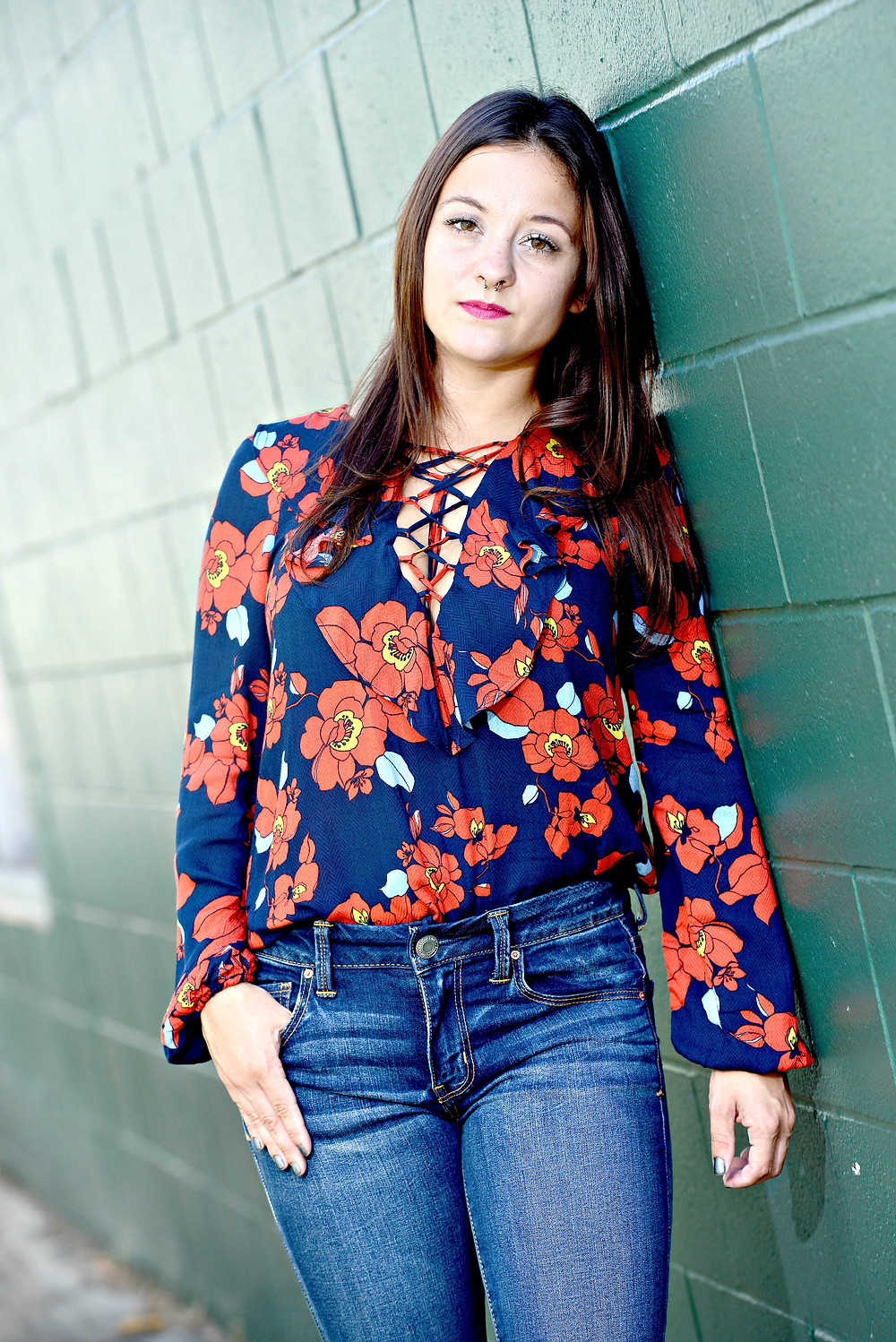 A style blogger wears a floral lace-up blouse from Forever 21.