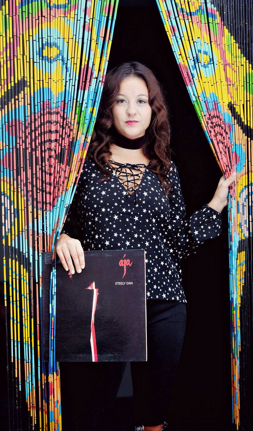 "A style and music blogger holds the ""Aja"" vinyl record by Steely Dan."