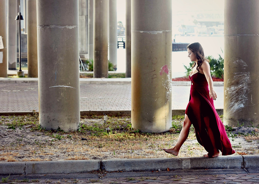 A style blogger walks on the edge in an oxblood maxi dress.