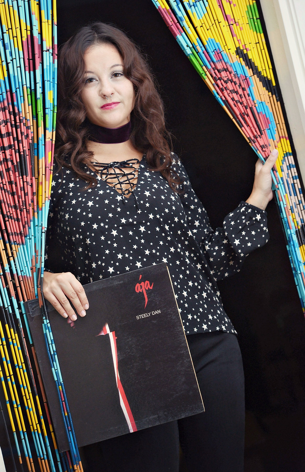 "A music blogger holds the ""Aja"" vinyl record by Steely Dan."
