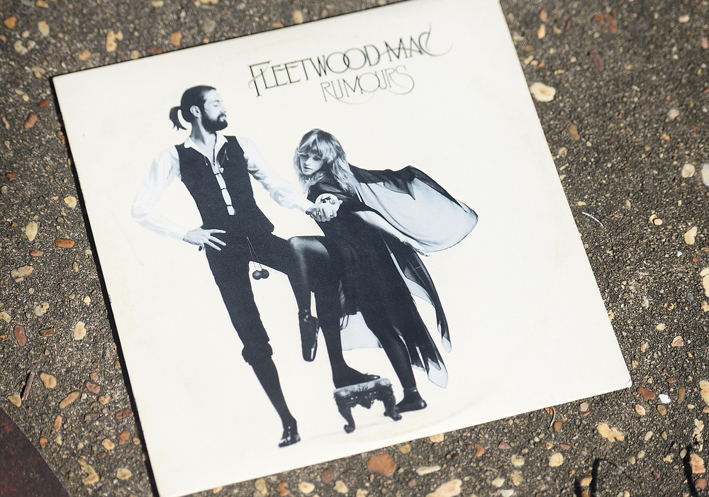 "A music blogger features the ""Rumours"" vinyl record by Fleetwood Mac."