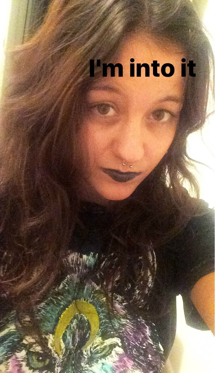 Beauty blogger tests black lipstick color on Snapchat.