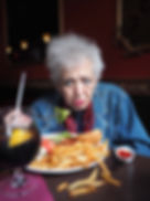 Cyrille eats lunch at the assisted living facility,
