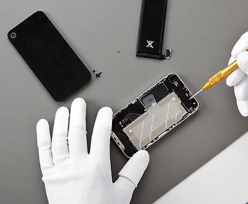 hands repairing cell phone