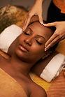 Masseur giving woman amazing scalp massa