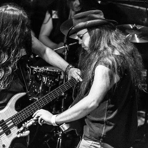 Howie G - Interacting with Tabbie Williams, Bass Player, on stage with Lawless
