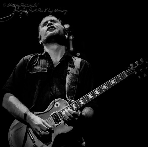 Black and White Image of Howie G playing Goldie, Les Paul Gold Bullion