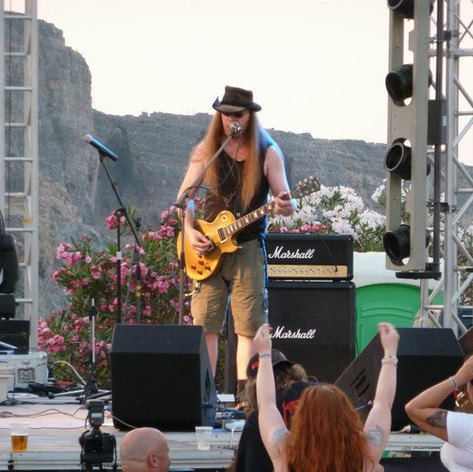 Playing in Lindos - Open air stage, backdrop of mountains playing Les Paul Gold Bullion