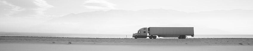 Truck-long-snowy-road_edited_edited.jpg