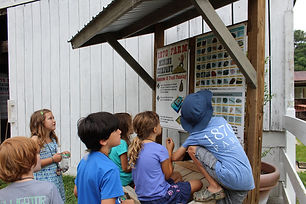Kids looking at Poster.JPG