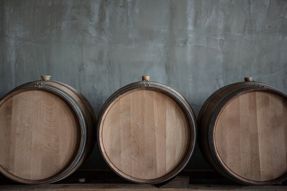 wine-barrels-stacked-in-the-cellar-of-the-winery.jpg