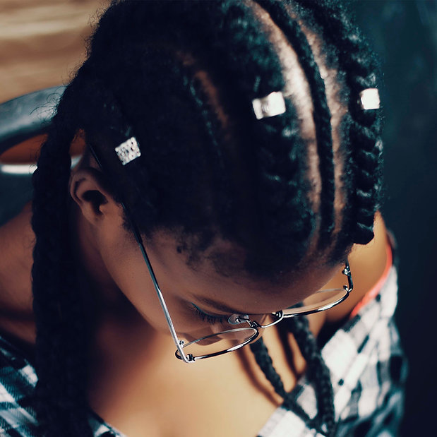 black girl with braids in natural type 4 hair