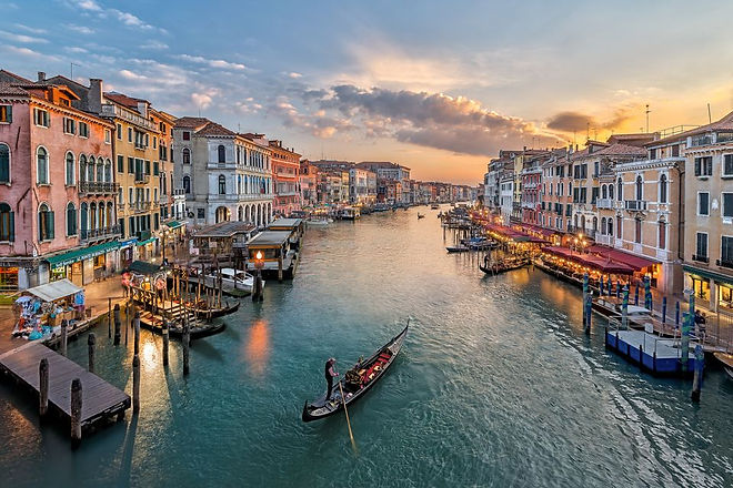 italy--venice--elevated-view-of-canal-in-city-543346423-59812f179abed50010eeb207.jpg