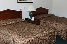 hotel rooms at the sundowner motel in lake george new york with lake views and private beach