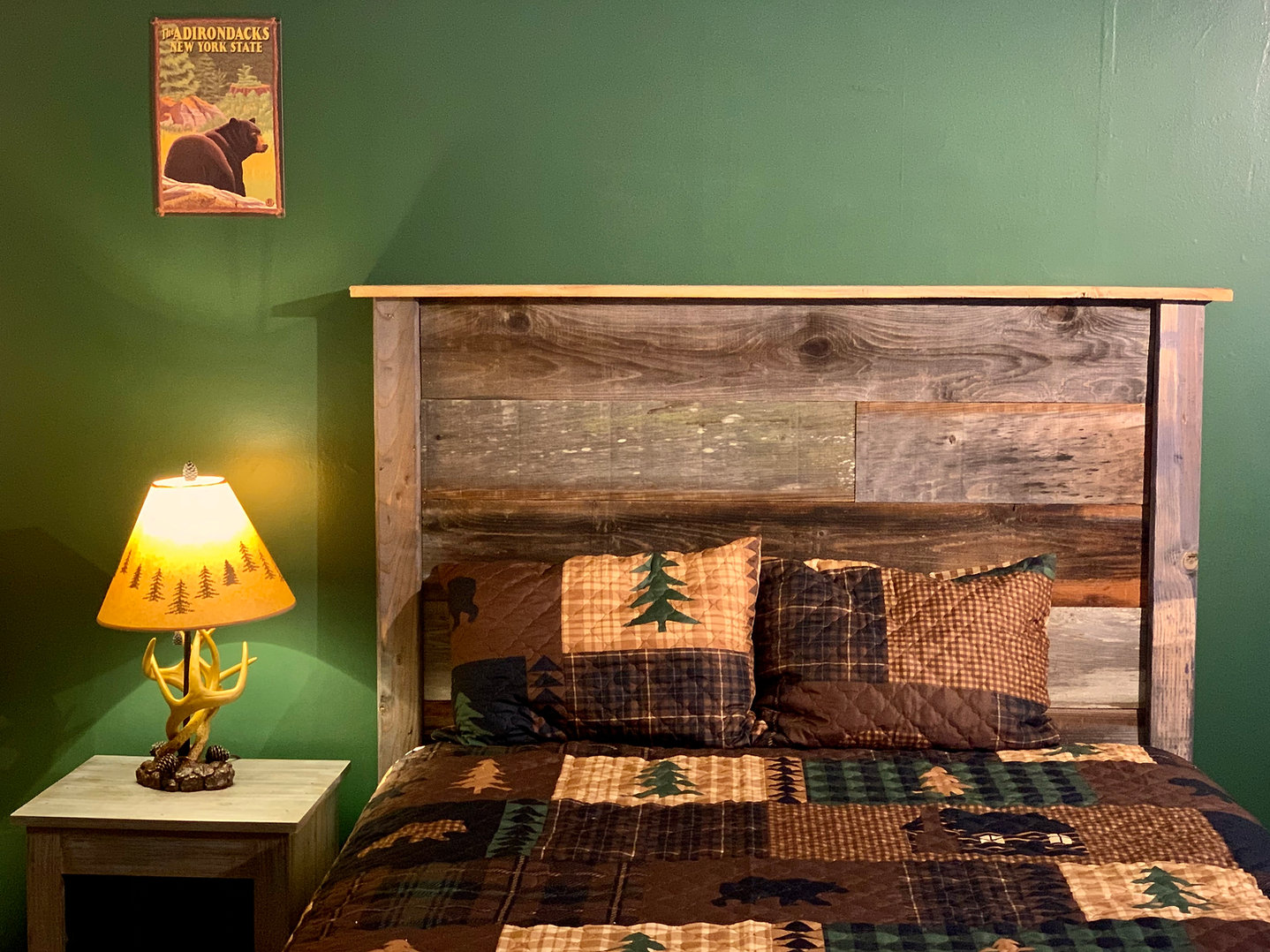 rustic adirondack themed handmade headboard and bed at the lake george motel montreal