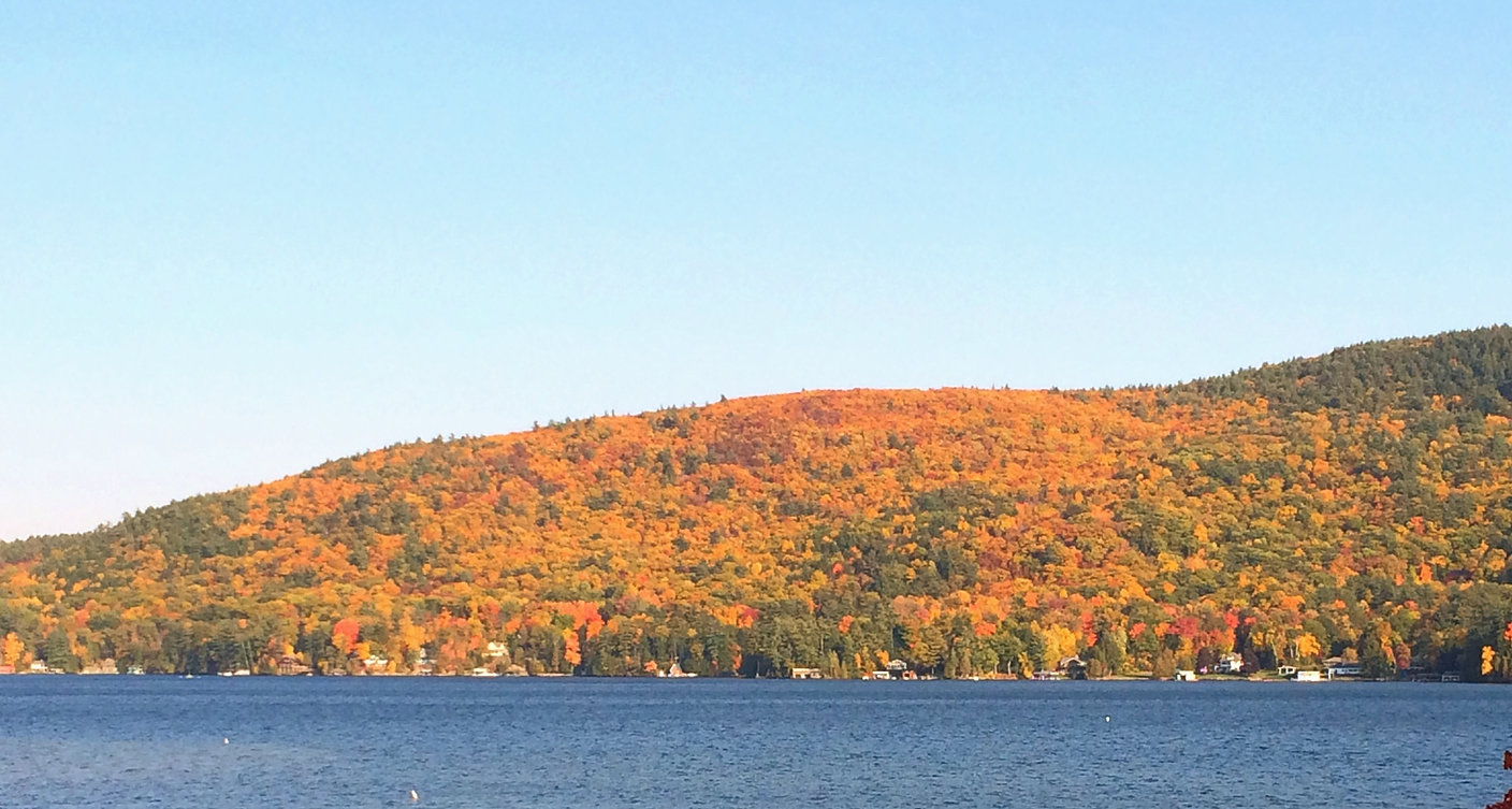 Lake George and the Adirondack Mountains in the Fall showing beautiful autumn colors and foliage
