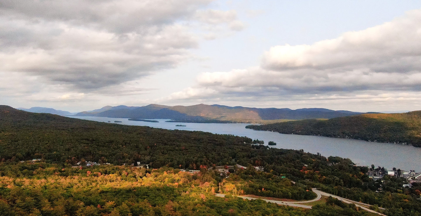 scenic panoramic view of lake george, lake george village and the adirondack mountains from prospect mountain in lake george