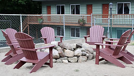 adirondack fire pit near the pool and sundeck at the lake george motel montreal located at 3 lake avenue in lake george ny