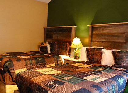 newly renovated hotel  room with two double beds and kitchentte at the lake george motel montreal in lake george ny