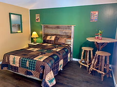newly renovated efficiency with a kithcenette and hand crafted rustic furniture at the lake george motel montreal