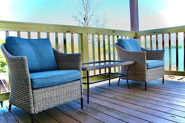 outdoor seating area on private deck overlooking lake george at the sundowner on lake george in lake geroge new york