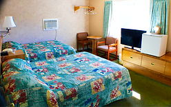 two beds in a sunny hotel room at the Lake Haven Motel in Lake George NY
