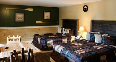 lakeside hotel room with  two queen beds and a kitchentte and views of lake george at the sundowner on lake george in lake george new york