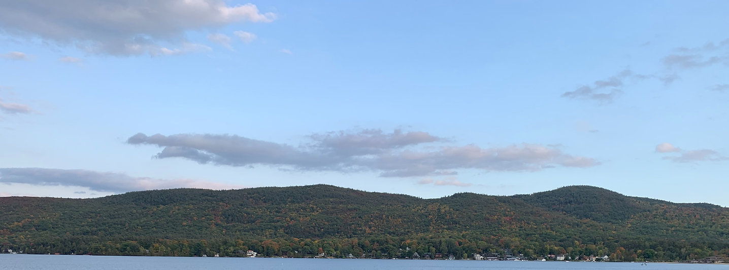 Blue skies with scattered clouds over lake george and the adirondack mountains