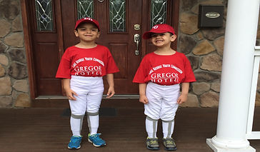 two little boys wearing a Gregor hotels little league basball uniform for Lake George youth commission