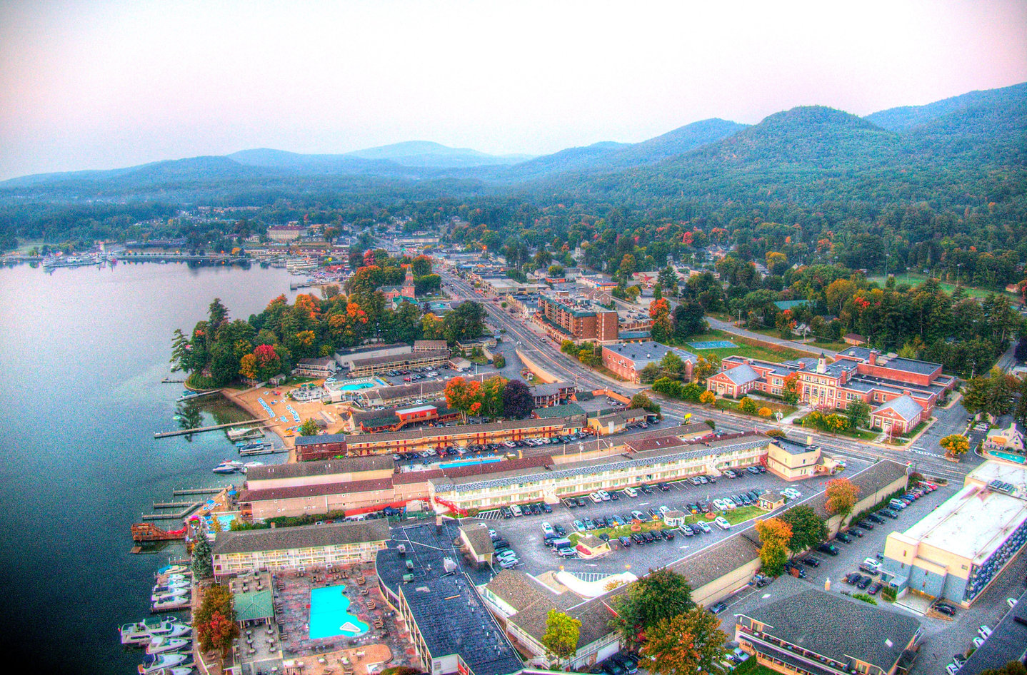aerial view of lake george village with the adirondack mountains in the background