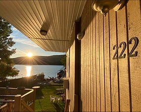 exterior of room 222 at the sundowner on lake george with the sun rising over the waters of lake george and the adirondack mountains in the distance