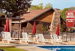 Sundeck, lounge chairs and swimming pool at the Lake George Motel Montreal