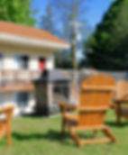 outdoor fireplace and adirondack chairs at the lake george motel montreal