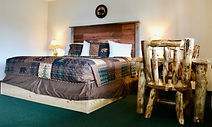 lakeside room with a king bed at the sundowner on lake george