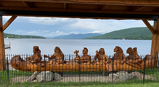 Detailed wooden carving of Mohican Native Americans overlooking Lake George and the Adirondack Mountains