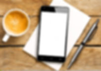 smartphone-blank-screen-coffee-pen-notep