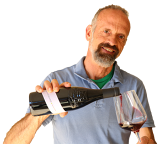 Henri Bungener, organic winegrower, winemaker, clos de caveau holiday let owner. Here he's pouring wine in a glass.