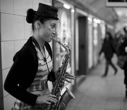 The Lady Saxophone at Oxford Street Station by Virginie Petorin