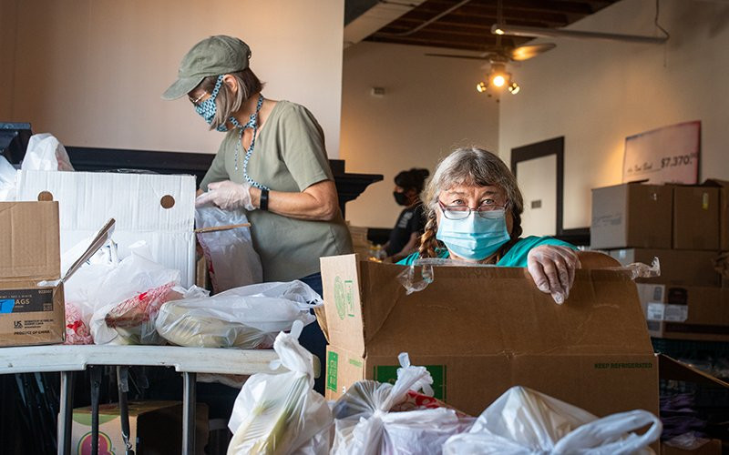 Pam Hollinde, right, and Janet Thrush volunteer with the Ajo Center for Sustainable Agriculture. Thrush, a retired nurse, has been helping out since April, and Hollinde started lending a hand in August, after moving to town. When COVID-19 hit, the center transformed a cafe into a de facto food pantry.