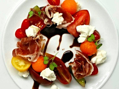 Acron fed prociutto with goatscheese, melon and heirloom tomatoes | RECIPE