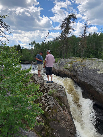 Matt and Friend admiring the drop of Collins Rapids