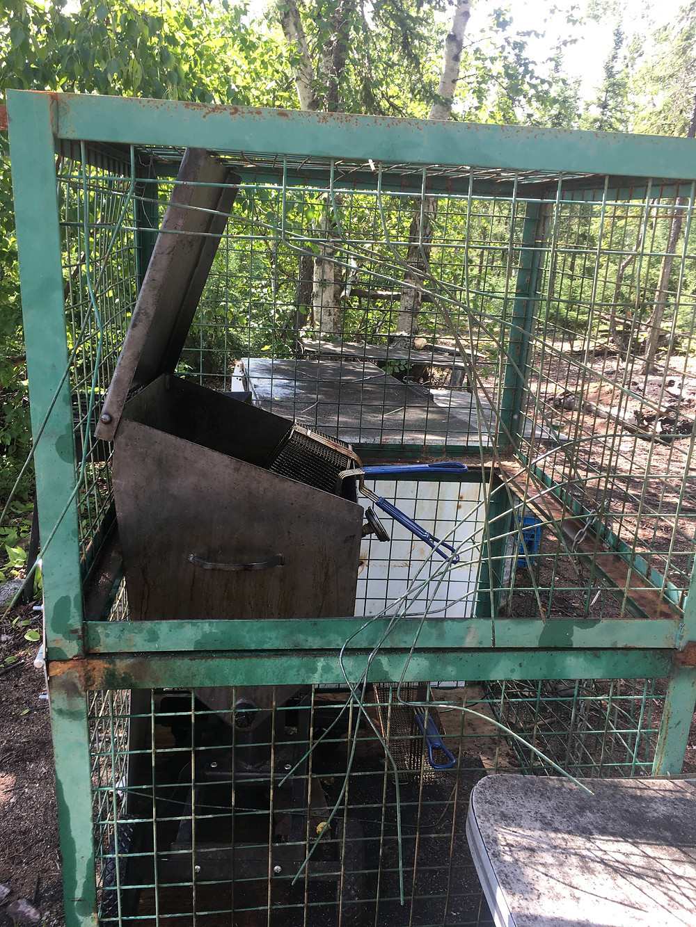 deep fryer cage at shore lunch that a bear destroyed!
