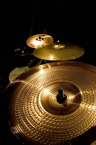 103523149-some-cymbals-on-black-backgrou