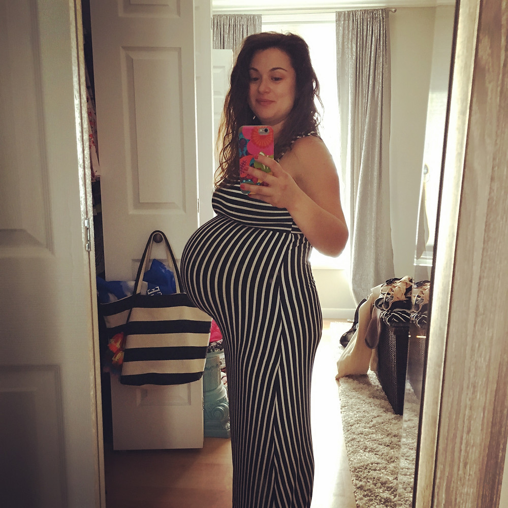 This is me at 9 months pregnant with Baby #2. Women should not be punished for being mothers.